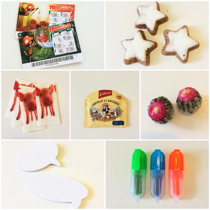 Mes cadeaux du calendrier de l'Avent au bureau : des tickets à gratter (non gagnants), des biscuits de Noël à la cannelle, un paquet de mouchoirs avec des petits cochons (dois-je y voir un message ?), du chocolat à l'ancienne Villars, deux fleurs de thé, des post-it et des mini stabilos